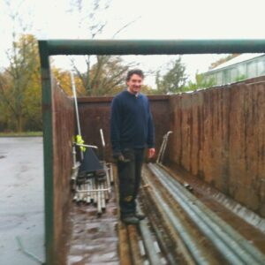 We are removing a lot of the old pipe heating from the glasshouse. Here is Gary providing a sense of scale for the skip and pipes #bigandheavy